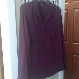Long Sleeve button down shirt 100% polyester.
